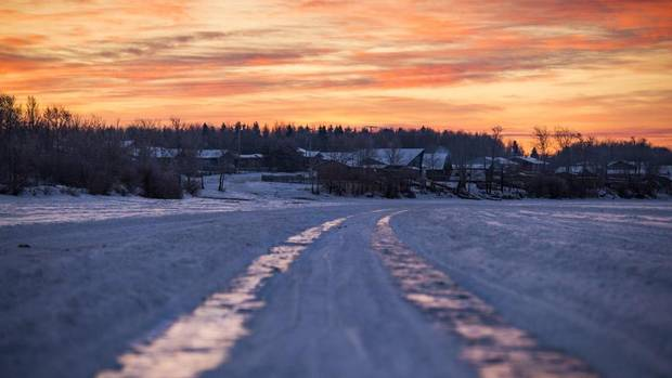 The ice road on Lac La Loche that leads toward the town.