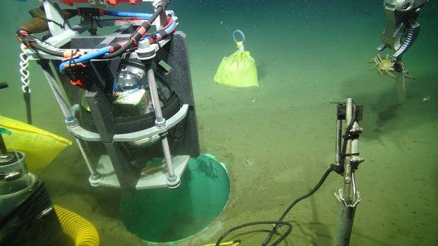 An accelerometer capable of detecting seismic vibrations is installed on the ocean bottom near the Cascadia subduction zone in June.