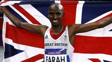 Britain's Mo Farah holds the Union Flag after winning the men's 10,000m final at the London 2012 Olympic Games at the Olympic Stadium August 4, 2012. (Reuters)