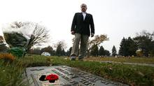 "Former fighter pilot, John ""Jock"" Williams poses for a portrait at the grave marker of his friend, a former pilot Captain Paul Rackham at Holy Cross Cemetery in Thornhill, Ontario, Canada. (Deborah Baic/Deborah Baic/The Globe and Mail)"