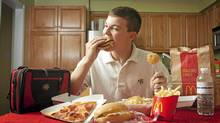 Justin Gullo chows down on Mom's wraps and Mickey D's. (Jennifer Roberts for The Globe and Mail/Jennifer Roberts for The Globe and Mail)