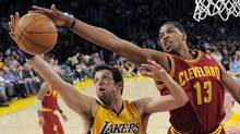 Los Angeles Lakers forward Jason Kapono, left, and Cleveland Cavaliers forward Tristan Thompson go after a rebound during the first half of their NBA basketball game, Friday, Jan. 13, 2012, in Los Angeles. (Mark J. Terrill/AP)