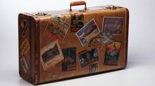 Old-fashioned brown suitcase with international labels stuck to it. (Photodisc)