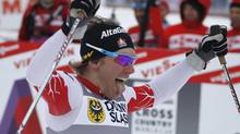Devon Kershaw of Canada celebrates winning the FIS World Cup men's cross-country skiing 1.6km free sprint competition in Szklarska Poreba. (PETER ANDREWS/Reuters)