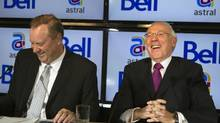Bell Canada Enterprises (BCE) president and chief executive officer George Cope (L) and Ian Greenberg (R), president and chief executive officer of Astral Media Inc., share a laugh while speaking at a news conference in Montreal, March 16, 2012. (REUTERS/Christinne Muschi/REUTERS/Christinne Muschi)