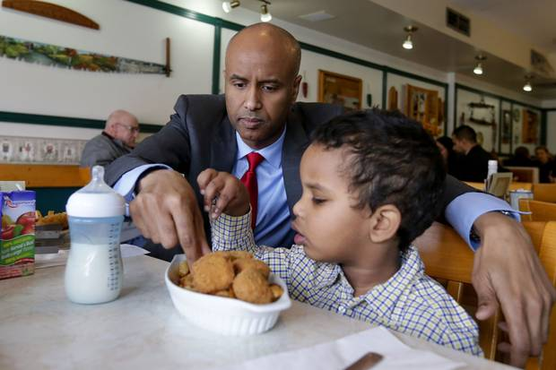 Mr. Hussen helps his middle son Maahir, 3, with his lunch at a fish-and-chips restaurant.