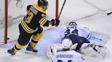 Boston Bruins' Brad Marchand (L) celebrates after his teammate Patrice Bergeron scored the overtime winner on Toronto Maple Leafs goalie James Reimer in Game 7 of their NHL Eastern Conference quarter-final hockey playoff series in Boston, Massachusetts May 13, 2013. (BRIAN SNYDER/REUTERS)