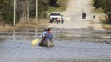 Paddlers take to flooded streets in Central Ontario, April 23, 2013. (Fred Thornhill for the GLOBE AND MAIL)