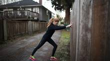 Martha Switzer, co-founder and CEO of Sprout at Work – a Canadian startup that builds social fitness trackers for employers – stretches during a jog in Vancouver on Dec. 7, 2013. (RAFAL GERSZAK FOR THE GLOBE AND MAIL)