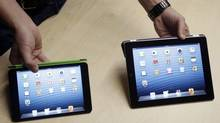 The iPad Mini, at left, is shown next to the fourth-generation iPad. (Marcio Jose Sanchez/AP)