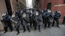 Riot police move through a downtown alley during the G20 summit in Toronto on June 25, 2010. (Mark Blinch/Reuters/Mark Blinch/Reuters)