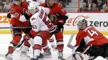 Ottawa Senators' Erik Karlsson (L), Matt Gilroy and goalie Craig Anderson stop Carolina Hurricanes' Jeff Skinner (C) (BLAIR GABLE/REUTERS)