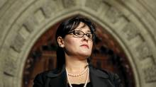 Canada's Health Minister Leona Aglukkaq listens to a statement during a news conference in the House of Commons foyer on Parliament Hill in Ottawa December 3, 2009. (BLAIR GABLE/REUTERS/Blair Gable)