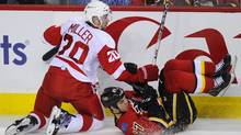 Calgary Flame Lance Bouma is knocked down by Detroit Red Wings Drew Miller. (Todd Korol/Reuters/Todd Korol/Reuters)