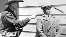 Erich von Stroheim, right, on the set of Greed – in the company of a knife thrower. (Everett Collection)