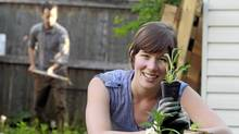 Julia Monkman plants sage as her boyfriend Alec prepares for a new flower bed behind her at home in Montreal, May 21, 2010. (Christinne Muschi/Christinne Muschi for the Globe and Mail)