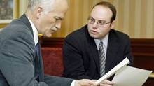 NDP Leader Jack Layton goes over notes with Pierre Ducasse, his special Quebec advisor, on Feb. 1, 2005 in Montreal (Paul Chiasson/Paul Chiasson/The Canadian Press)