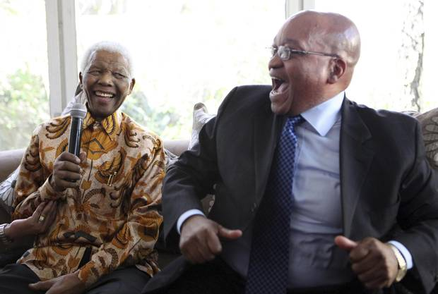 Former South African president Nelson Mandela, left, celebrates his 91st birthday alongside long-time friend Jacob Zuma in Johannesburg in 2009.