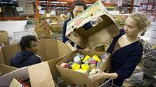 Volunteers at the Great Vancouver Food Bank sort incoming donations at a warehouse on Oct. 25. (John Lehmann/The Globe and Mail/John Lehmann/The Globe and Mail)