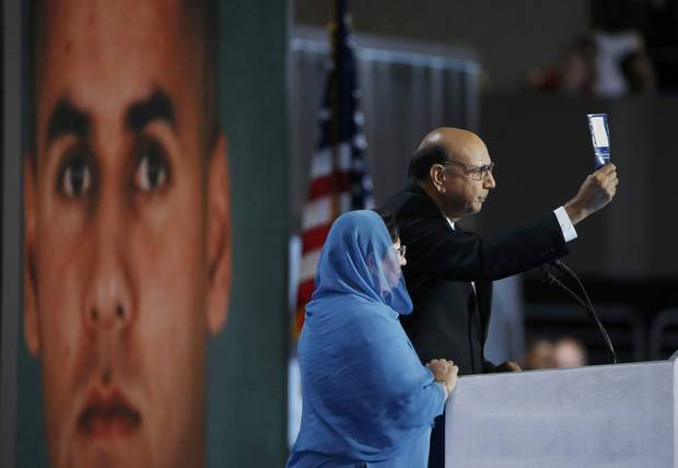 Khizr Khan, whose son was killed serving in the U.S. Army, challenges Republican presidential nominee Donald Trump to read his copy of the U.S. Constitution.