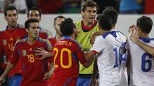 Spain and Chile players argue at the end of their international friendly soccer match against Chile in St.Gallen, September 2, 2011. Spain won the match 3-2. REUTERS/Christian Hartmann (Christian Hartmann/Reuters)