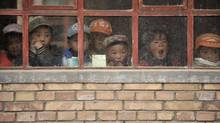 Children look out from a window of their classroom at a rural primary school in Min county, Gansu province. The school, with five teachers and 102 students, is on a mountain more than 2,000 metres high. (SHENG LI/REUTERS)
