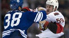 Toronto Maple Leafs left winger Fraser McLaren (38) knocks Ottawa Senators left winger Dave Dziurzynski out during a fight in first period NHL action in Toronto on Wednesday March 6, 2013. (FRANK GUNN/THE CANADIAN PRESS)