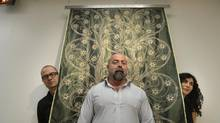 From left, RAD's Christos Marcopoulos, Rodolphe el-Khoury and Carol Moukheiber. The green object is their IM Blanky, a blanket containing a network of sensors. (Fred Lum/The Globe and Mail)