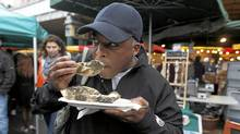 Dean Jacobs of Calgary tries the oysters at the famous Borough Market in London, England. (Jim Ross for The Globe and Mail/Jim Ross for The Globe and Mail)