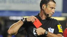 Referee Mark Clattenburg holds a red card after sending off Chelsea's Branislav Ivanovic during their English Premier League soccer match against Manchester United at Stamford Bridge in London October 28, 2012. (TOBY MELVILLE/REUTERS)
