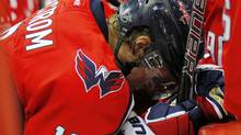 Washington Capitals center Nicklas Backstrom (19) bends over on the bench after being hit by Calgary Flames left wing Rene Bourque (not pictured) in the third period at Verizon Center. Backstrom received a concussion on the play. The Capitals won 3-1. Mandatory Credit: Geoff Burke-US PRESSWIRE (Geoff Burke/US PRESSWIRE)