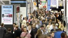 Visitors navigate an aisle on the trade show floor during the 2012 International Consumer Electronics Show (CES) in Las Vegas, Nevada January 11, 2012. CES, the world's largest consumer technology tradeshow, runs through January 13. (STEVE MARCUS/Steve Marcus/Reuters)