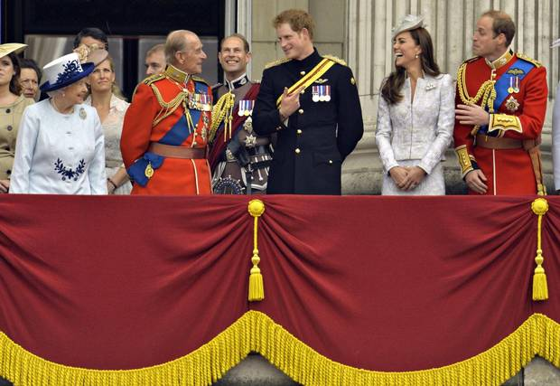 The Queen, Prince Philip, Prince Harry and William and Catherine, Duke and Duchess of Cambridge, stand on the balcony of Buckingham Palace in the annual Trooping of the Colour ceremony on June 14, 2014.