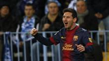 Barcelona's Lionel Messi celebrates after scoring a goal against Malaga during their Spanish First Division soccer match at La Rosaleda stadium in Malaga, southern Spain January 13, 2013. (JON NAZCA/REUTERS)