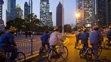 Construction workers ride along a street at central Shanghai, Jan. 15, 2014. (Aly Song/Reuters)