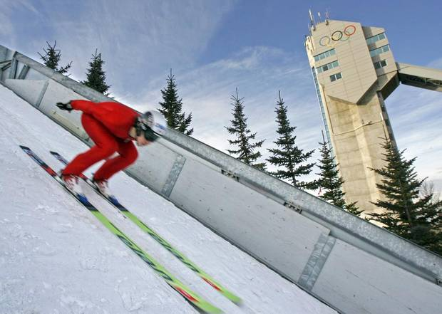 Ski jumper Trevor Morrice tucks down the track before soaring during a training session at Canada Olympic Park in Calgary on Dec. 23, 2006.
