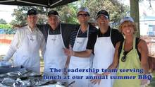 Leadership team serves lunch at Kruger Products' annual summer barbecue. The firm pays its bonuses just before RRSP contribution time, says Lucie Martin, corporate director of talent management.