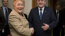 Quebec Premier Pauline Marois greets New Brunswick Premier David Alward at her office in Montreal, Monday, February 18, 2013. (Graham Hughes/THE CANADIAN PRESS)