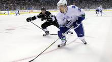 Vancouver winger Jannik Hansen's style of play is similar to Burrows's but he lacks chemistry with the Sedin twins. (Mark J. Terrill/AP)