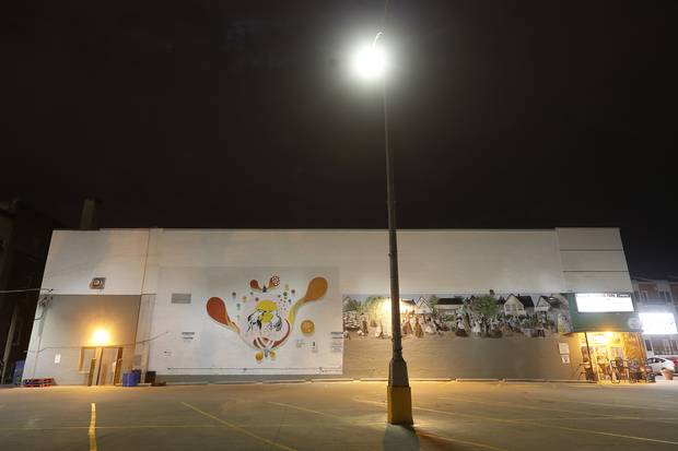 Lovely Puppy love by Gabrielle Funk and Takashi Iwasaki was painted on grocery store in the West