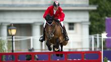 Canada's Ian Millar, from Perth, Ont., rides his horse Star Power over a jump in the Equestrian Individual Jumping final 2012 Summer Olympics Wednesday, August 8, 2012 in London. (The Canadian Press)