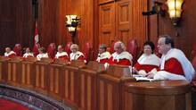 Canada's Supreme Court judges look on from the bench during a ceremony welcoming Mr. Justice Thomas Cromwell, right, in Ottawa on Feb. 16, 2009. (CHRIS WATTIE/REUTERS)