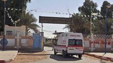 An ambulance enters a hospital located near the gas plant where hostages have been kidnapped by Islamic militants, in Ain Amenas, Algeria, on Jan. 19, 2013 (Anis Belghoul/AP)