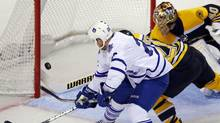 Toronto Maple Leafs right wing Colton Orr shoots and misses against Boston Bruins goaltender Tuukka Rask (R) in the third period of Game 1 of their NHL Eastern Conference Quarterfinals hockey playoff series in Boston, Massachusetts May 1, 2013. (BRIAN SNYDER/REUTERS)