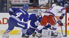 New York Rangers' Chris Kreider scores a goal past Toronto Maple Leafs goalie Jonathan Bernier, centre, as Cody Franson defends during second period NHL action in Toronto, Saturday January 4, 2014. (Mark Blinch/THE CANADIAN PRESS)