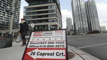 The CityPlace condominium development in downtown Toronto has a mix of commercial storefronts and residential units above. (Fred Lum/The Globe and Mail)