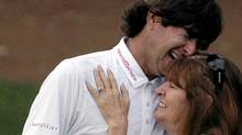 Bubba Watson cries as he hugs his mother Molly after winning the Masters golf tournament on April 8, 2012. (Matt Slocum/Associated Press)