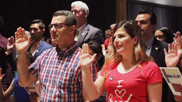 People take the citizenship oath at Pier 21 immigration centre in Halifax on Saturday, July 1, 2017.