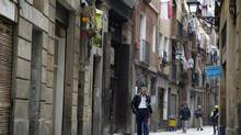 A street in the El Raval neighborhood in Barcelona, Nov. 21, 2012. Local merchants say the unemployment figure in El Raval ranges from 50 per cent to 70 per cent. The numbers are credible, given Spain's national unemployment rate of 25 per cent, the highest among Western nations. (Albert Gea for The Globe and Mail)
