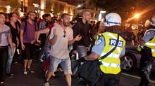 Protesters jeer and scream at police as they push them back away from the Grand Prix festival area in Montreal. (Peter McCabe/Canadian Press)